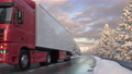 Front view of semi-trailer truck passing the camera on a snowy countryside road 73622470