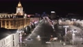 Ekaterinburg, Russia, City Administration beautiful building and the central square. Stock footage. Night city landscape with beautiful street and houses illumination on black sky background.  73646858