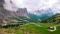 4K Timelapse of Sassolungo mountain and Gardena Pass in summer, South Tyrol, Italy 73649329