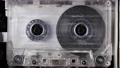Close-up A tape recorder is playing an audio cassette. Close-up. A vintage audio cassette spins on a blank label tape used to record sound in a retro cassette player. Recording of conversations. 73675961