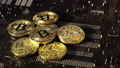Close up shot of Gold Bitcoins coins isolated on motherboard background. Crypto currency, bitcoin. BTC, Bit Coin. Blockchain technology, bitcoin mining. 73677235