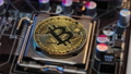 Crypto currency Gold Bitcoin - BTC - Bit Coin. Bitcoins on the motherboard. 73677237