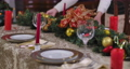 Close-up of table with unrecognizable mother and son putting New Year decoration on it. Preparation of Christmas dinner at home indoors in living room. Cinema FullHD ProRes HQ. 73707884