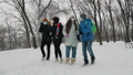 Schoolchildren wearing masks throw snowballs in the park in winter 73728850