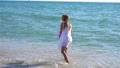 Cute little girl at beach during caribbean vacation 73760731
