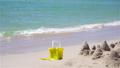 Beach kid's toys on white sand beach 73760783