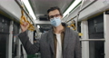 Portrait of man in protective medical mask looking to camera. Male person in wireless earbuds 73792782