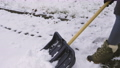 Woman start removing snow with shovel.Winter concept  73794297