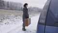 Woman hitchhiker with vintage suitcase refuses from stranger car 73794298