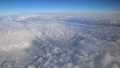 Stunning footage of aerial view above clouds from airplane window with blue sky. view from the airplane window to the blue sky and white clouds 73801474