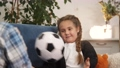 dad play ball with daughter at home. kid dream stay home happy family concept. dad and daughter play have fun throwing a ball to each lockdown other sitting on the couch at home 73812223