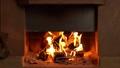 Fireplace lit inside the house 73812885