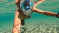 Snorkeling near a tropical island. Young man swims in the water. Sea vacation. 73837868