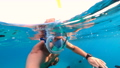 Snorkeling near a tropical island. Young man swims in the water. Sea vacation. 73837876