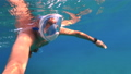 Snorkeling near a tropical island. Young man swims in the water. Sea vacation. 73837882