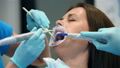 Dentist And Assistant Examine Patient With Braces In Denal Office. 73852154