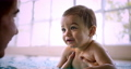 Little baby learning to swim with mother in indoor pool 73906191