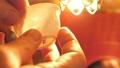 A thin porcelain cup is translucent. Tea ceremony. Handwork 73944402
