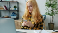 Happy girl using smartphone texting having fun with device alone in apartment 73957346