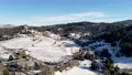 Aerial view of historic Downtown City of Julian during snow day. 74054778