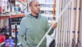 Buyer selects plastic building corners in a store 74059373