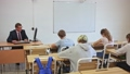Adult teacher is giving lecture for students in the class 74059374