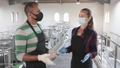 Portrait of winery workers in protective masks at work closeup 74059376