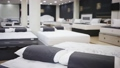 Closeup of new modern orthopaedic mattress on display for sale in large furniture store 74059378