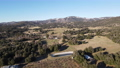 Aerial view of valley with farmland an forest in Julian, California, USA 74086969