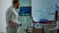 Scientist worried about virus evolution analysing DNA scan image 74130280