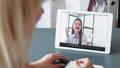video call virtual meeting female employee tablet 74227459