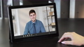 online conference video meeting employee tablet 74227467