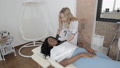 Pretty young African dark skinned lady lying on the couch and receiving beauty injections. Beautician makes anti-aging injection on woman lips. Rejuvenation and beauty treatments. 74274699