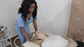 Aesthetic surgery. Young blond Caucasian girl having beauty injections in salon. Pretty young African woman doctor cosmetologist in blue medical suit making injection into her face skin 74275248