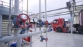 Levers and meter on pipeline at gas and oil refinery complex 74279533