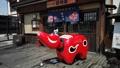 大型紅色beko Akabeko Aizu吉祥物,福島縣會津地區的當地玩具 74354778