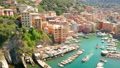 Aerial view of Camogli harbor. Colorful buildings near the ligurian sea beach, Italy. View from above on boats and yachts moored in marina with green blue water. 74408565