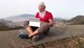 Senior man with laptop 74431442