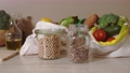 Eco friendly cotton bags with food products and and glass stuff on kitchen table 74575198