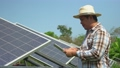 Asian farmers use tablets to adjust solar cells degree and check solar cell performance after rain and Dust and dirt stains on the solar cell. Concept of farming technology. 74588707