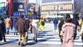 Tokyo cityscape Slow motion of people crossing the Shibuya crossing in the afternoon 74618145
