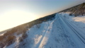 FPV drone view. Fast flight over the railway in the winter forest at sunset 74622582