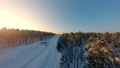 FPV drone view. Fast flight over the railway in the winter forest at sunset 74623566