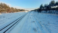 FPV drone view. Fast flight over the railway in the winter forest at sunset 74623575