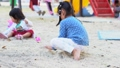 The little Asian girl is playing the sand on the playground. Playing is a learning development. And build muscle for children. 74628270