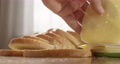 Making Bread with Cheese Sandwich at the Table in the Kitchen 74640798