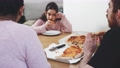 Multinational family eating vegan pizza at home 74679482