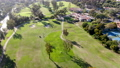 Aerial view over golf field. 74680665