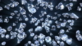 Many jewelry diamond stones shinning and falling on black with lights 74707146