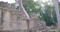Landscape view of demolished stone architecture and aerial tree root at Preah Khan temple Angkor Wat complex, Siem Reap Cambodia. A popular tourist attraction nestled among rainforest.  74717461